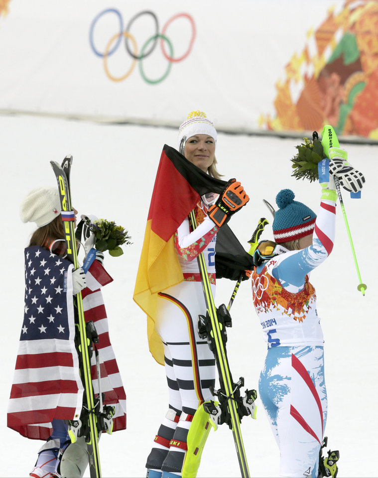Photo - Women's supercombined medalists, from left United States' Julia Mancuso, bronze, Germany's Maria Hoefl-Riesch, gold, and Austria's Nicole Hosp, silver, stand on the podium during a flower ceremony at the Alpine ski venue at the Sochi 2014 Winter Olympics, Monday, Feb. 10, 2014, in Krasnaya Polyana, Russia. (AP Photo/Charles Krupa)