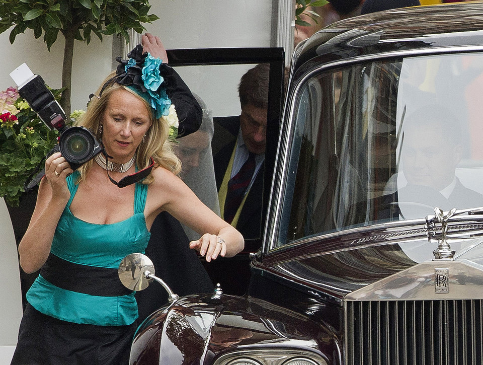 Photo - Kate Middleton, second from left, enters a car as she leaves the Goring Hotel to make her way to Westminster Abbey ahead of her Royal Wedding to Britain's Prince William, London, Friday, April, 29, 2011. (AP Photo/Joel Ryan, Pool) ORG XMIT: LENT107