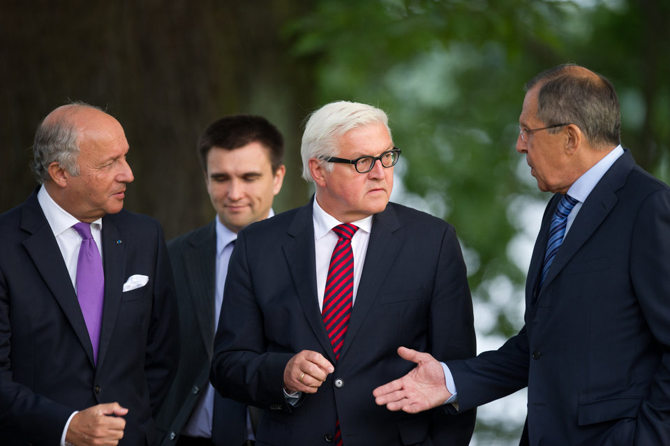 Photo - Foreign Ministers of France Laurent Fabius, Ukraine Pavlo Klimkin, Germany Frank-Walter Steinmeier and Russia Sergey Lavrov, from left, go for a walk before a meeting at the Guesthouse of Foreign Ministry Villa Borsig in Berlin, Sunday, Aug. 17, 2014. (AP Photo/Steffi Loos)