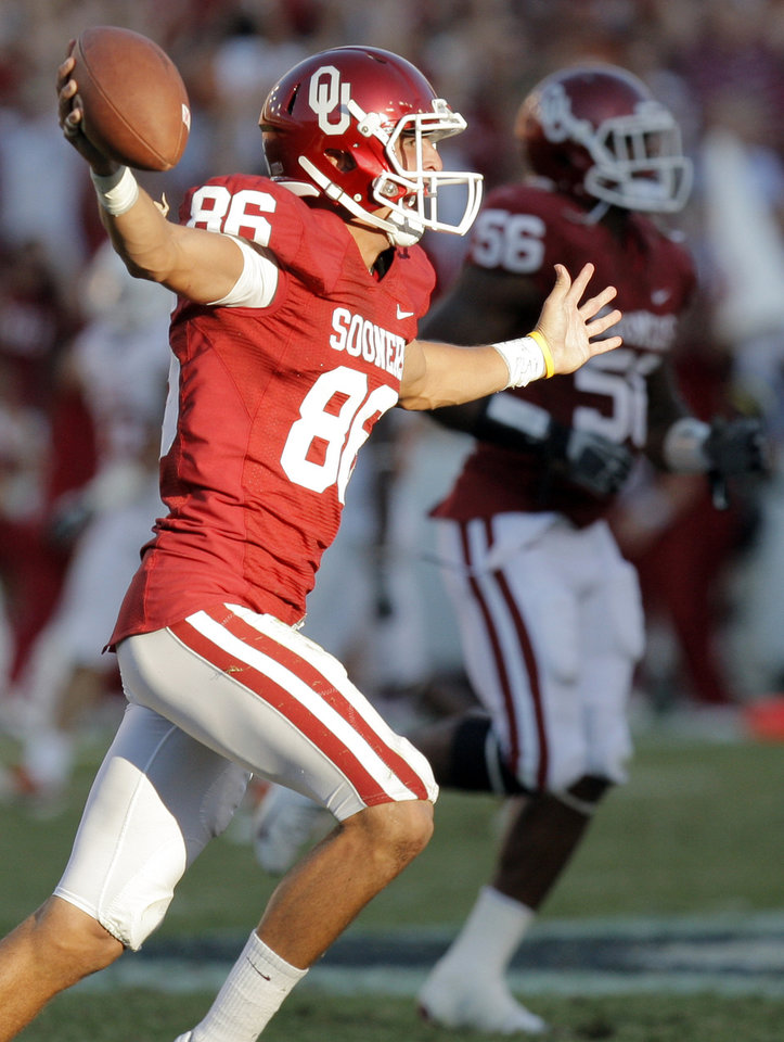 Photo - OU's James Winchester (86) reacts after recovering a fumbled punt return by Texas late in the fourth quarter during the Red River Rivalry college football game between the University of Oklahoma Sooners (OU) and the University of Texas Longhorns (UT) at the Cotton Bowl on Saturday, Oct. 2, 2010, in Dallas, Texas. OU won, 28-20. Photo by Nate Billings, The Oklahoman