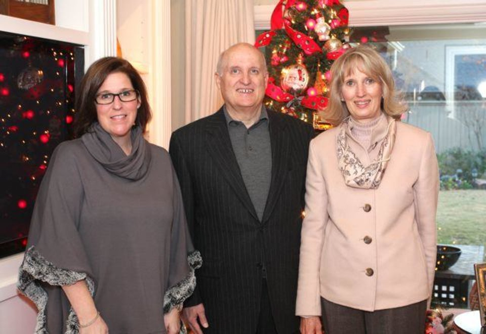 Angela Payne Reynolds, Barry and Anne Gray were at the Lakehurst neighborhood party in the Reynolds home. It followed a Christmas home tour. (Photo by David Faytinger, For The Oklahoman).