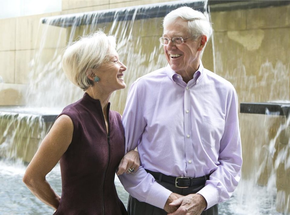Photo - This photo taken Sept. 26, 2012 shows Charles and Liz Koch at Koch Headquarters in Wichita, Kansas. The Kochs are demonized by Democrats, who lack a liberal equal to counter their weight, and not entirely understood by Republicans, who benefit from their seemingly limitless donations. Married 44 years Liz says she is the only one that has cut his hair since they've been married.  (AP Photo/The Wichita Eagle, Bo Rader)