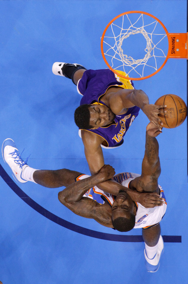 Oklahoma City's Kendrick Perkins (5) goes to the basket beside Los Angeles' Andrew Bynum (17) during Game 1 in the second round of the NBA playoffs between the Oklahoma City Thunder and L.A. Lakers at Chesapeake Energy Arena in Oklahoma City, Monday, May 14, 2012. Photo by Bryan Terry, The Oklahoman