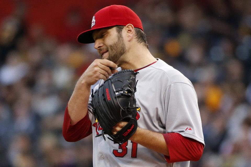 Photo - St. Louis Cardinals starting pitcher Lance Lynn collects himself between pitches during the second inning of a baseball game against the Pittsburgh Pirates in Pittsburgh, Saturday, May 10, 2014. (AP Photo/Gene J. Puskar)