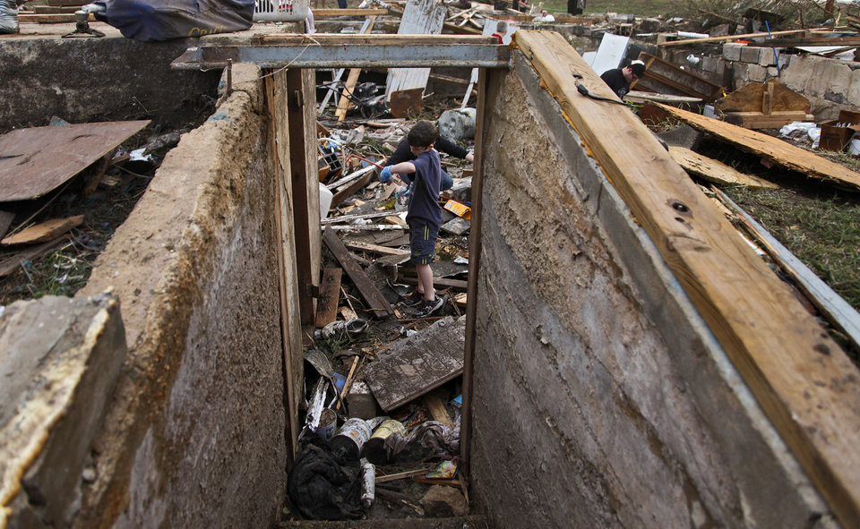 Landon Grysham helps look for personal items in the destroyed home of Tom Chronister north of El Reno, Tuesday, May 24, 2011. Photo by Chris Landsberger, The Oklahoman ORG XMIT: KOD