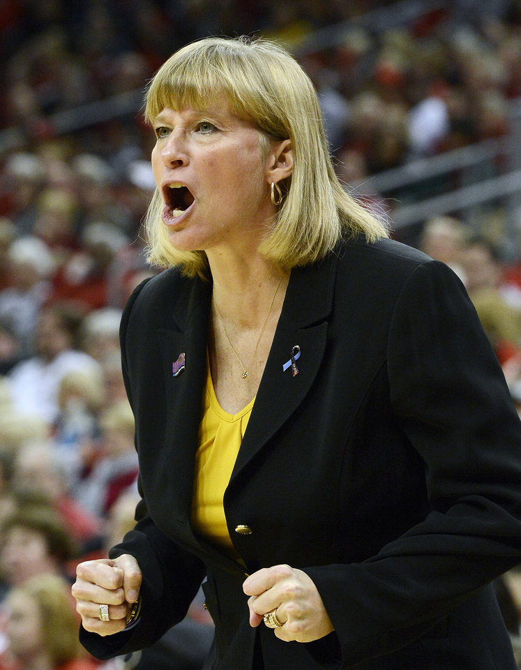 Purdue head coach Sharon Versyp shouts at the officials during the first half of their second round game in the women's NCAA college basketball tournament in Louisville, Ky., Tuesday March 26, 2013. Louisville defeated Purdue 76-63. (AP Photo/Timothy D. Easley)