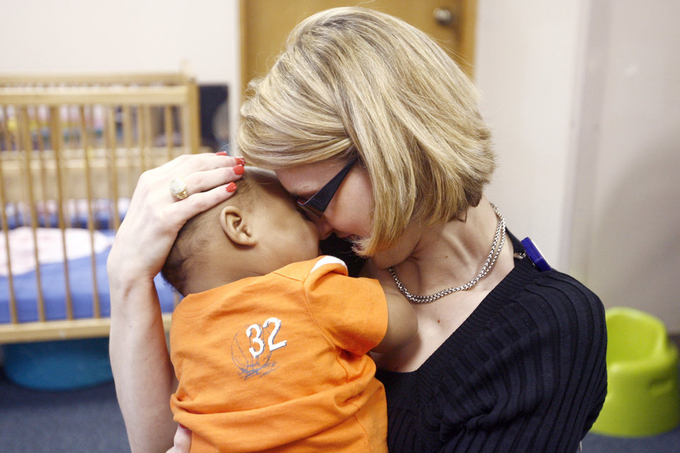 SECOND PLACE, WEB PHOTO: Tonya Ratcliff hugs, J.T., at his day care during lunchtime, Wednesday, April 23, 2008, in Oklahoma City. BY SARAH PHIPPS, THE OKLAHOMAN