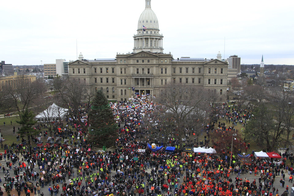 Thousands of supporters rally at the State Capitol grounds in Lansing, Mich., Tuesday, Dec. 11, 2012. The crowd is protesting right-to-work legislation that was passed by the state legislature last week. (AP Photo/Carlos Osorio) ORG XMIT: MICO108