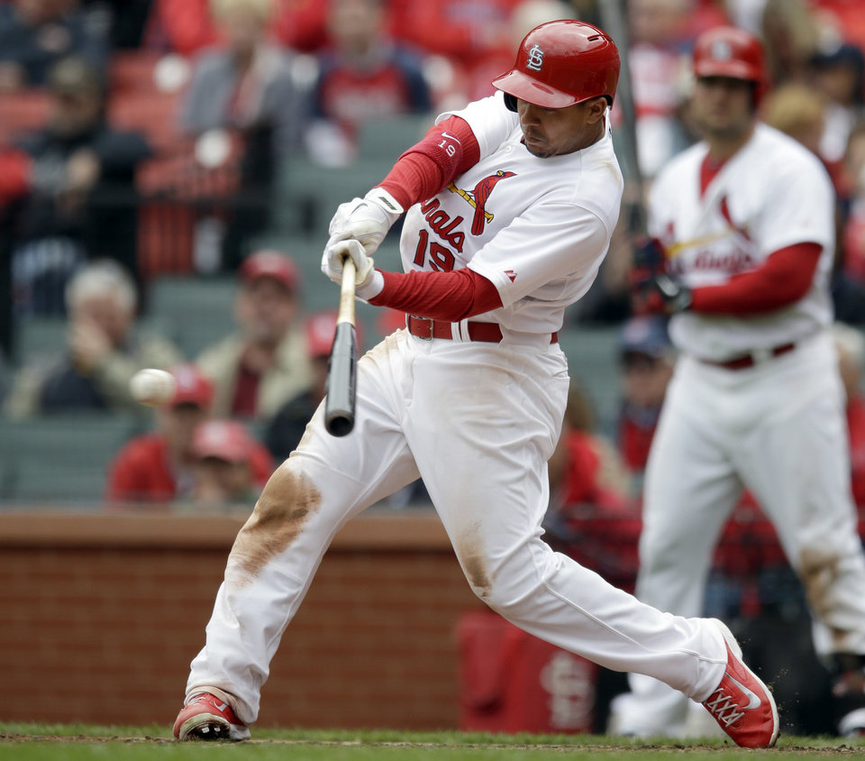 Photo - St. Louis Cardinals' Jon Jay hits an RBI double during the fifth inning of a baseball game against the Milwaukee Brewers Wednesday, April 30, 2014, in St. Louis. (AP Photo/Jeff Roberson)