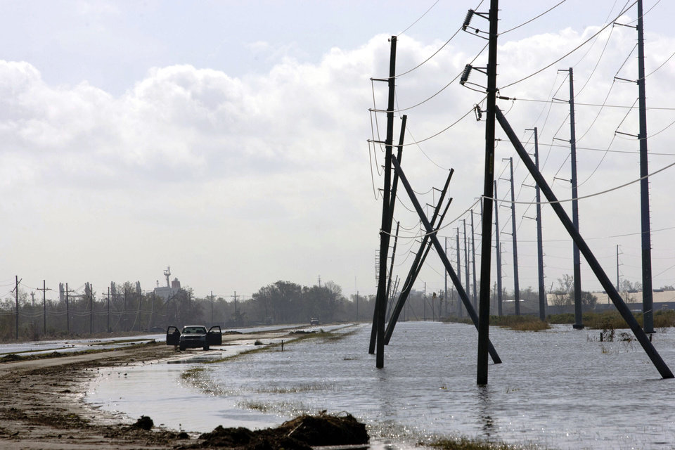 Photo -   A truck is stranded from receding flood waters from Hurricane Isaac along Louisiana Hwy 23 near Port Sulphur, La., in Plaquemines Parish, Monday, Sept. 3, 2012. The nation's oil and gas hub is slowly coming back to life in the aftermath of Hurricane Isaac. The government said Monday that offshore oil and gas platforms are beginning to ramp up production as crews are returning. (AP Photo/Matthew Hinton)