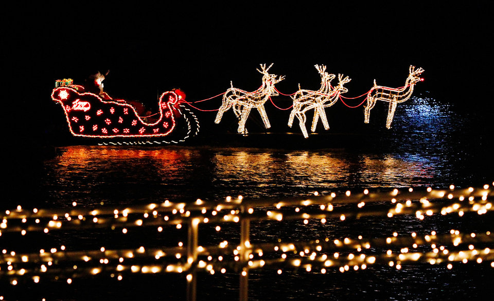 "Santa waves to crowds from his ""sleigh"" boat, the final entry in the procession of boats. Boat Parade and fireworks  on the Oklahoma River Friday night,   Nov. 25, 2011.  Photo by Jim Beckel, The Oklahoman"