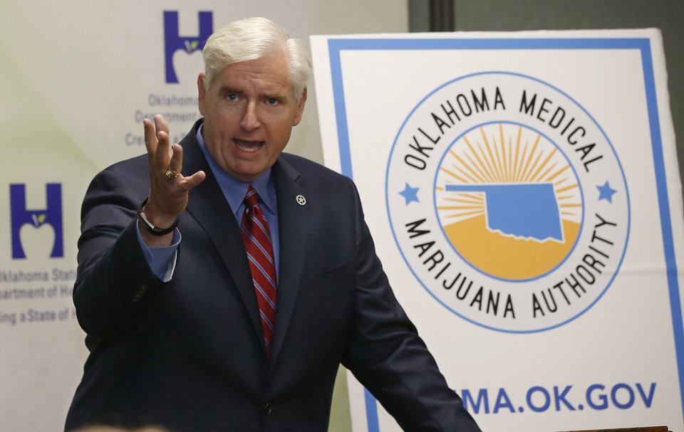 Photo - Tom Bates, Oklahoma's interim health commissioner, speaks during a news conference in Oklahoma City, Wednesday, July 27, 2018. Bates said the state's Department of Health will be ready to implement a new law allowing medical marijuana. (AP Photo/Sue Ogrocki)