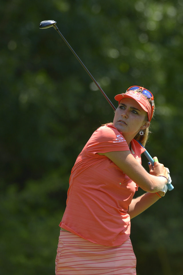 Photo - Lexi Thompson watches her tee shot on the fifth hole in the second round of the Airbus LPGA Classic golf tournament at Magnolia Grove on Friday, May 23, 2014,  in Mobile, Ala. (AP Photo/G.M. Andrews)