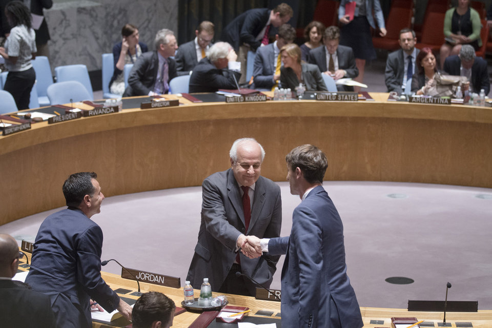 Photo - Palestinian U.N. Ambassador Riyad Mansour, center, shakes hands with a representative of France during a meeting of the U.N. Security Council on the worsening situation in Gaza at United Nations headquarters, Monday, July 28, 2014. The U.N. Security Council called for