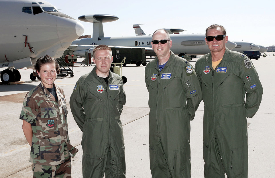 """Photo - From left, Air Force members 1st Lt. Kinder Blacke, Senior Airman Anthony Bahr, Lt. Col. Kerry Drake, and Lt. Col. Jimmy Warren — all involved in the making of the movie """"Transformers: Revenge of the Fallen"""" — stand in front of E-3 AWACS planes at Tinker Air Force Base near Midwest City. Photo By Paul Hellstern, The Oklahoman"""