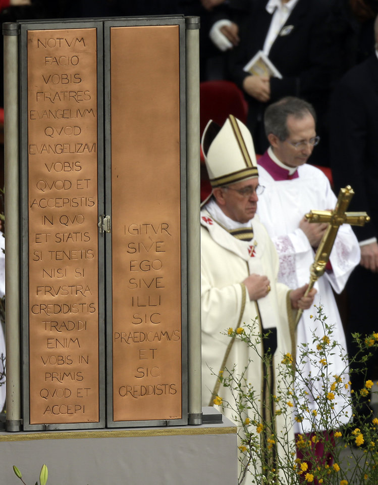 "Pope Francis, holding the pastoral staff, walks past the closed icon of Jesus as he celebrates the Easter mass in St. Peter's Square at the Vatican, Sunday, March 31, 2013. ""Our daily problems and worries can wrap us up in ourselves, in sadness and bitterness, and that is where death is,"" he said. ""Let the risen Jesus enter your life, welcome him as a friend, with trust: he is life!"" said Pope Francis during the Easter vigil. (AP Photo/Gregorio Borgia)"