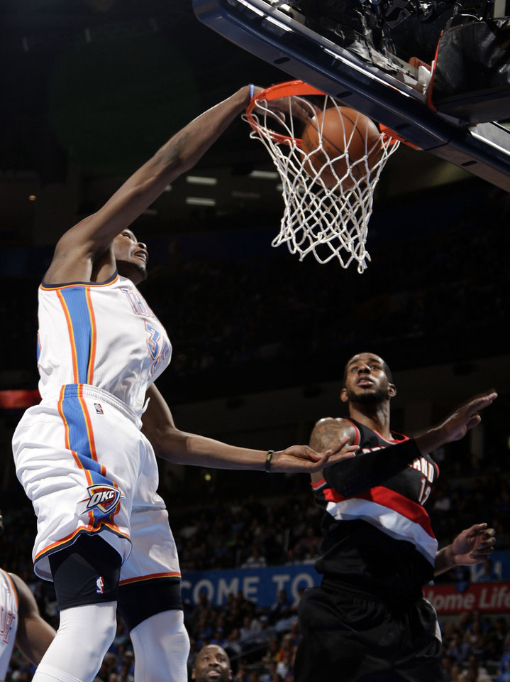 Oklahoma City's Kevin Durant (35) dunks over Portland 's LaMarcus Aldridge (12) during the NBA basketball game between the Oklahoma City Thunder and the Portland Trail Blazers at Chesapeake Energy Arena in Oklahoma City, Sunday, March 18, 2012. Photo by Sarah Phipps, The Oklahoman.