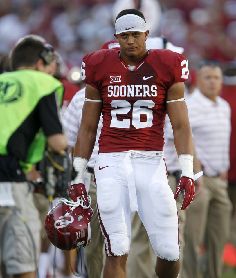 Photo - Oklahoma's Jordan Evans (26) leaves after getting ejected from the game on a penalty during a college football game between the University of Oklahoma Sooners (OU) and the Louisiana Tech Bulldogs at Gaylord Family-Oklahoma Memorial Stadium in Norman, Okla., on Saturday, Aug. 30, 2014. Photo by Bryan Terry, The Oklahoman