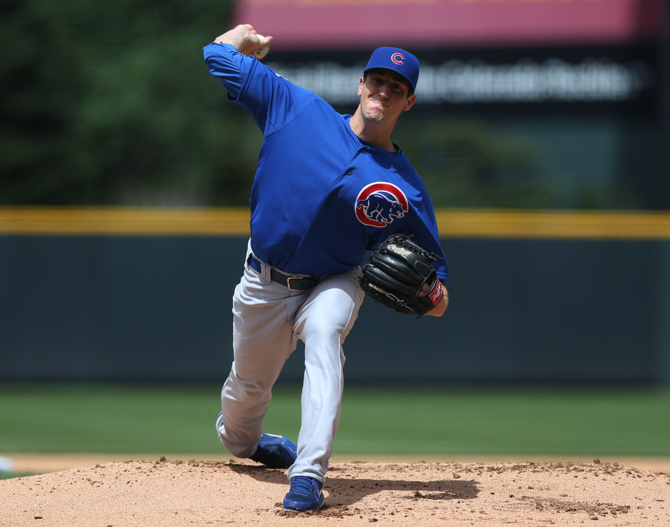 Photo - Chicago Cubs starting pitcher Kyle Hendricks works against the Colorado Rockies in the first inning of a baseball game in Denver on Thursday, Aug. 7, 2014. (AP Photo/David Zalubowski)