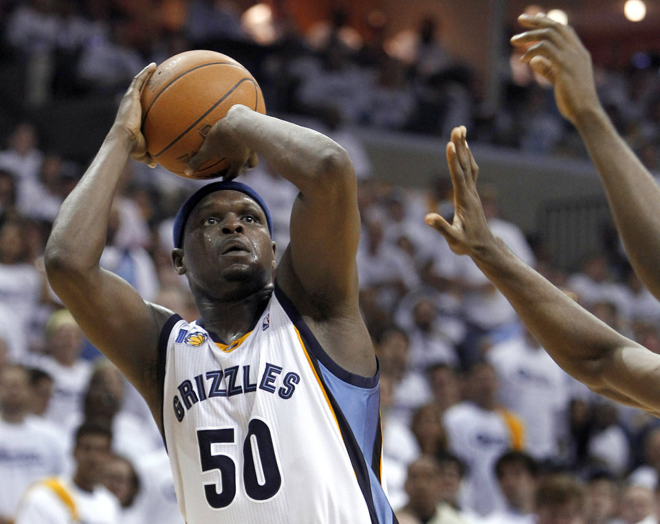 Memphis Grizzlies forward Zach Randolph shoots against the Oklahoma City Thunder during the first half of Game 4 of a second-round NBA basketball playoff series on Monday, May 9, 2011, in Memphis, Tenn. (AP Photo/Wade Payne)