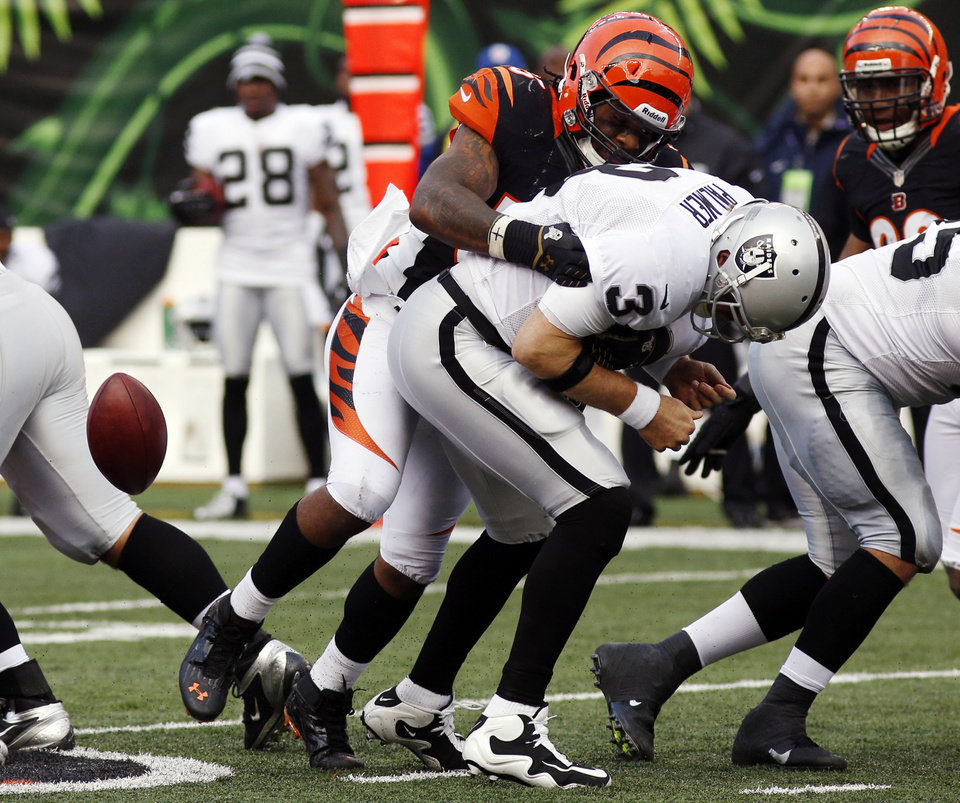 Photo -   Oakland Raiders quarterback Carson Palmer (3) fumbles the ball as he is sacked by Cincinnati Bengals outside linebacker Vontaze Burfict in the second half of an NFL football game, Sunday, Nov. 25, 2012, in Cincinnati. Cincinnati recovered the ball and won 34-10. (AP Photo/David Kohl)