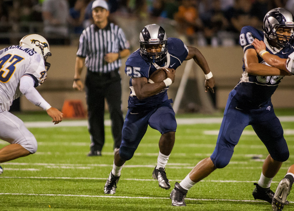 Cypress Ridge running back Rennie Childs (25) carries the ball during the third quarter of a high school football game at Pridgeon Stadium on Saturday, Oct. 6, 2012, in Houston. Cypress Ranch defeated Cypress Ridge 35-28. ( Andrew Richardson / For the Chronicle ) ORG XMIT: 446939