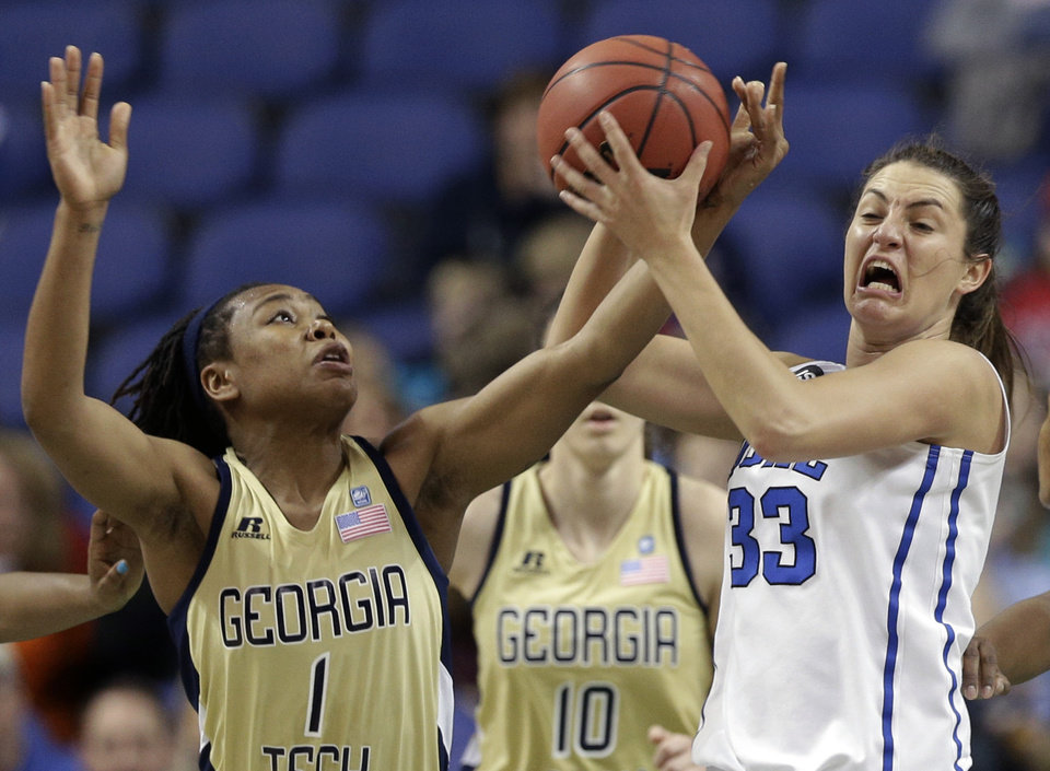 Photo - Duke's Haley Peters (33) is fouled by Georgia Tech's Dawnn Maye (1) during the first half of an NCAA college basketball game at the Atlantic Coast Conference tournament in Greensboro, N.C., Friday, March 7, 2014. (AP Photo/Chuck Burton)