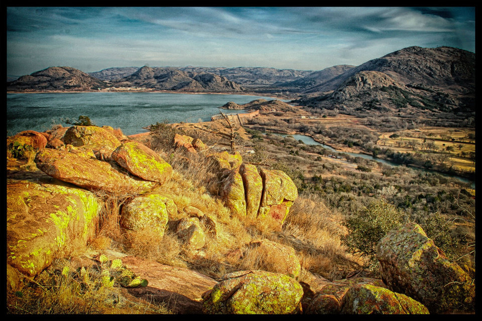 """Lake Lugert and dam cradled by Wichita Mountains"" Image taken at Quartz Mountain state park looking southeast toward dam. Photo by Mark Meacham"