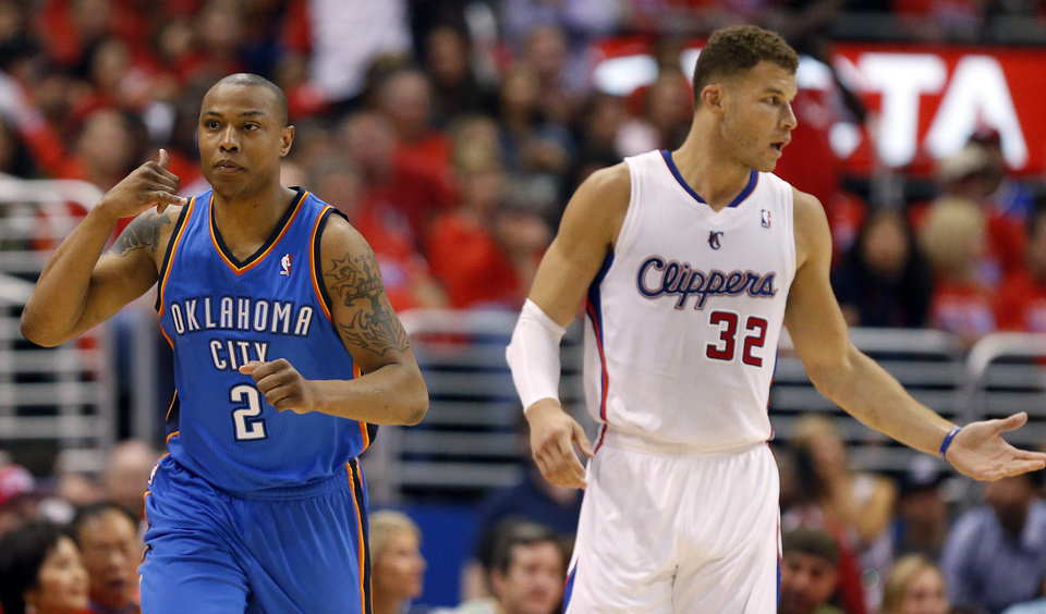 Photo - Oklahoma City's Caron Butler (2) celebrates next to Los Angeles' Blake Griffin (32) during Game 3 of the Western Conference semifinals in the NBA playoffs between the Oklahoma City Thunder and the Los Angeles Clippers at the Staples Center in Los Angeles, Friday, May 9, 2014. Photo by Nate Billings, The Oklahoman