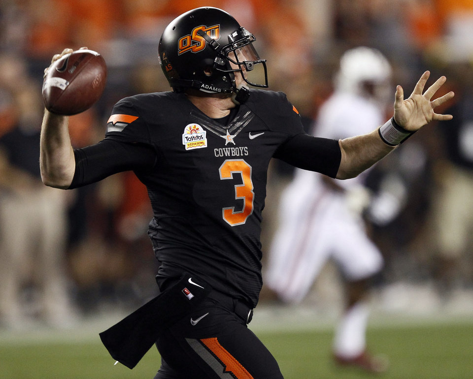 Oklahoma State quarterback Brandon Weeden (3) throws against Stanford during the first half of the Fiesta Bowl NCAA college football game Monday, Jan. 2, 2012, in Glendale, Ariz. (AP Photo/Matt York)