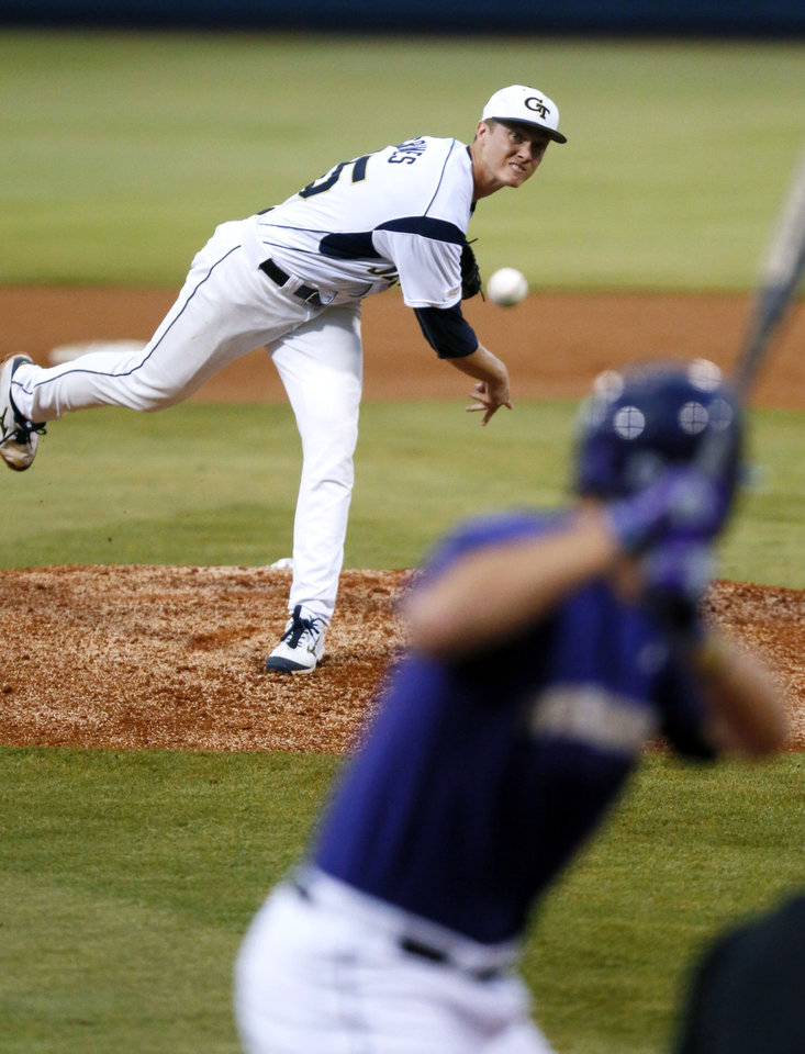 Photo - Georgia Tech pitcher Matthew Grimes (25) throws a first inning pitch to a Washington player at their NCAA college baseball regional tournament game in Oxford, Miss., Sunday, June 1, 2014. (AP Photo/Rogelio V. Solis)