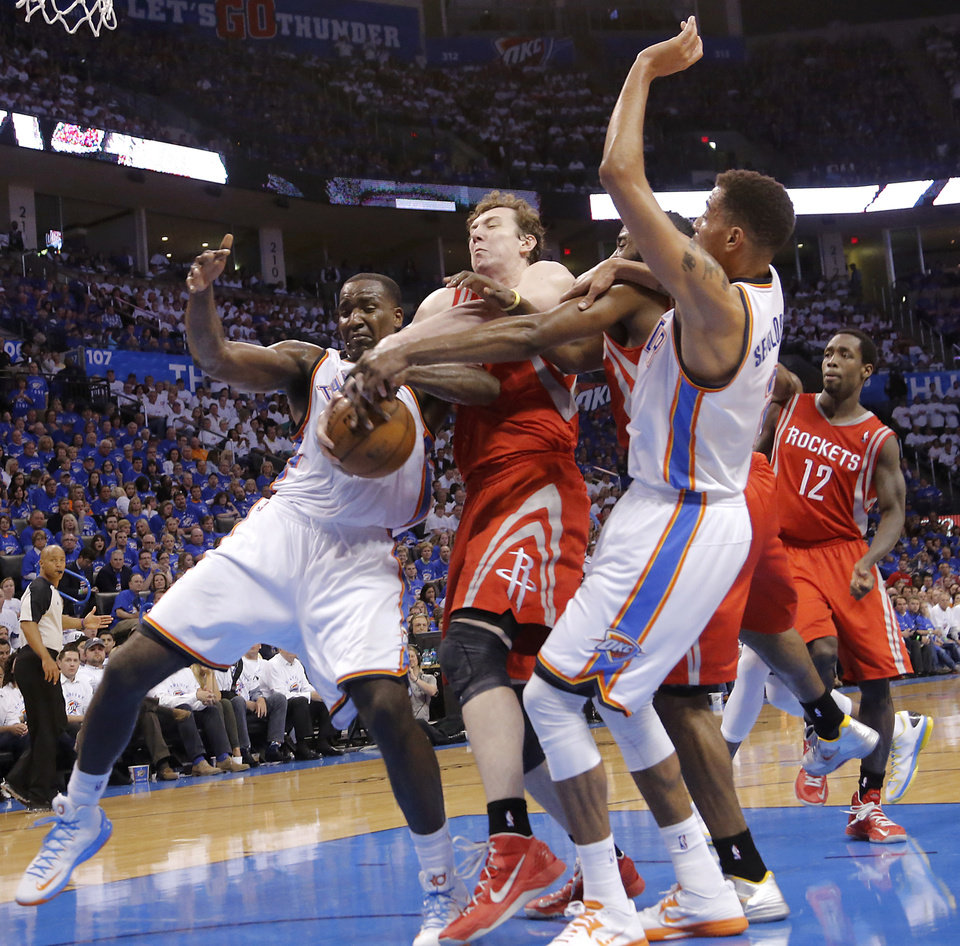 Oklahoma City\'s Kendrick Perkins (5) and Thabo Sefolosha (2) battle under the basket with Houston\'s Omer Asik (3) during Game 2 in the first round of the NBA playoffs between the Oklahoma City Thunder and the Houston Rockets at Chesapeake Energy Arena in Oklahoma City, Wednesday, April 24, 2013. Photo by Chris Landsberger, The Oklahoman