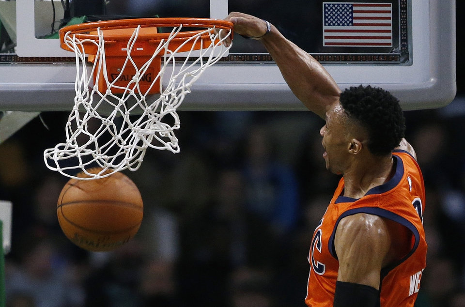 Photo - Oklahoma City Thunder's Russell Westbrook dunks during the first quarter of an NBA basketball game against the Boston Celtics in Boston, Wednesday, March 16, 2016. The Thunder won 130-109. (AP Photo/Michael Dwyer)