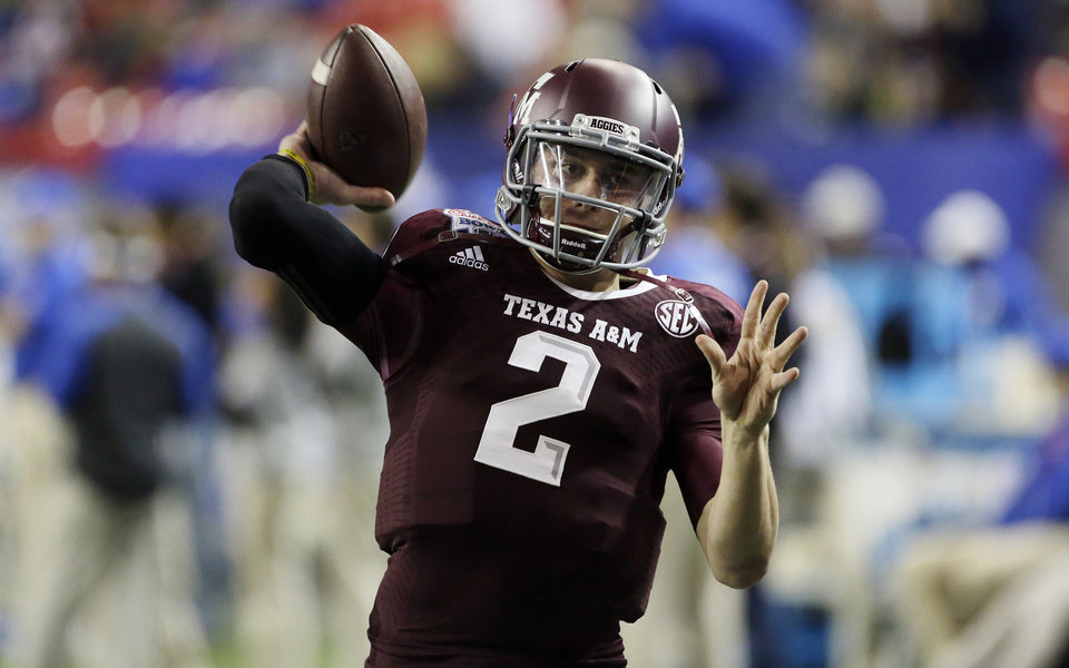 Photo - ADVANCE FOR WEEKEND EDITIONS, MAY 3-4 - FILE - In this Dec. 31, 2013, file photo, Texas A&M quarterback Johnny Manziel (2) warms up before the start of the Chick-fil-A Bowl NCAA college football game against Duke in Atlanta. Manziel is a 2012 Heisman Trophy winner was one of most exciting and productive players in college football history. He is a top prospect in the upcoming NFL draft. (AP Photo/John Bazemore, File)
