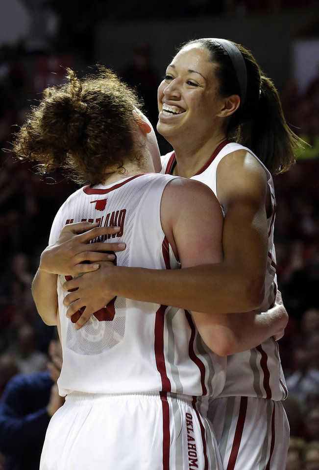 Oklahoma\'s Joanna McFarland (53) and Nicole Griffin (4) celebrate in the second half of the women\'s Bedlam basketball game between Oklahoma State University and Oklahoma at the Lloyd Noble Center in Norman, Okla., Sunday, Feb. 10, 2013.Photo by Sarah Phipps, The Oklahoman