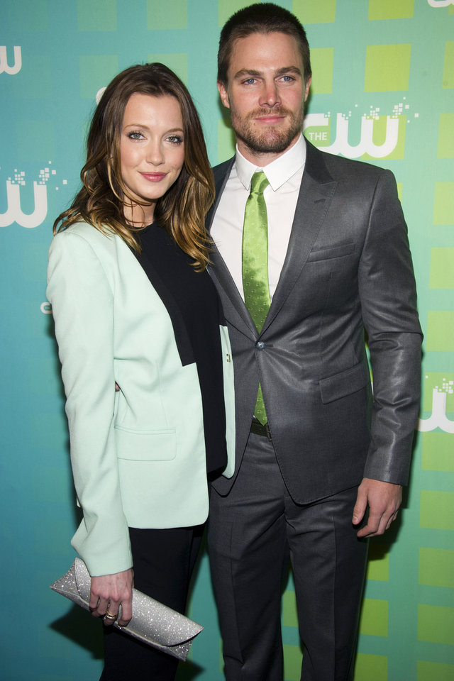 Photo -   Katie Cassidy and Stephen Amell attend The CW Television Network's Upfront 2012 in New York, Thursday, May 17, 2012. (AP Photo/Charles Sykes)