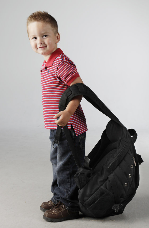 Photo - CHILDREN / KIDS: Avery Garrison-Rice, 3, models a backpack in the OPUBCO studio Thursday, July 23, 2009. Photo by Doug Hoke, The Oklahoman. ORG XMIT: KOD
