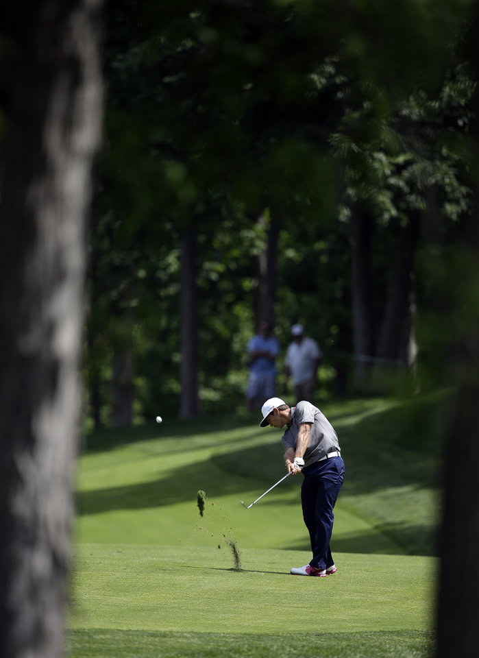 Photo - Thorbjorn Olesen, of Denmark, hits to the ninth green during the second round of the Memorial golf tournament Friday, May 30, 2014, in Dublin, Ohio. (AP Photo/Darron Cummings)