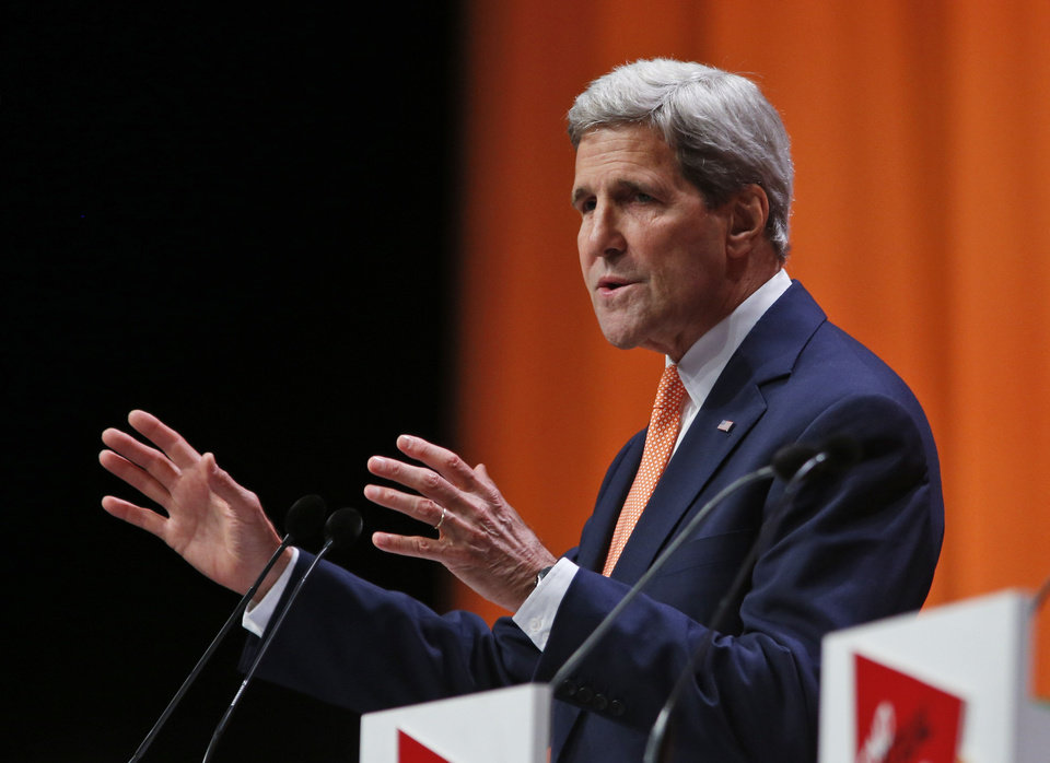 Photo - US Secretary of State John Kerry delivers his speech at the 'End Sexual Violence in Conflict' summit in London, Friday, June 13, 2014. The Summit welcomed governments from over 100 countries, over 900 experts, NGOs, Faith leaders, and representatives from international organisations across the world. (AP Photo/Lefteris Pitarakis)