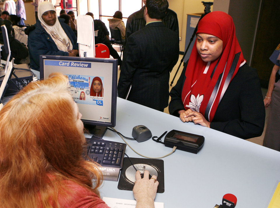 Photo - Monique Barrett has her photo taken for her driver's license with her traditional Muslim head scarf, at the Department of Public Safety in Oklahoma City, OK, Thursday, Feb. 19, 2009. BY PAUL HELLSTERN, THE OKLAHOMAN ORG XMIT: KOD