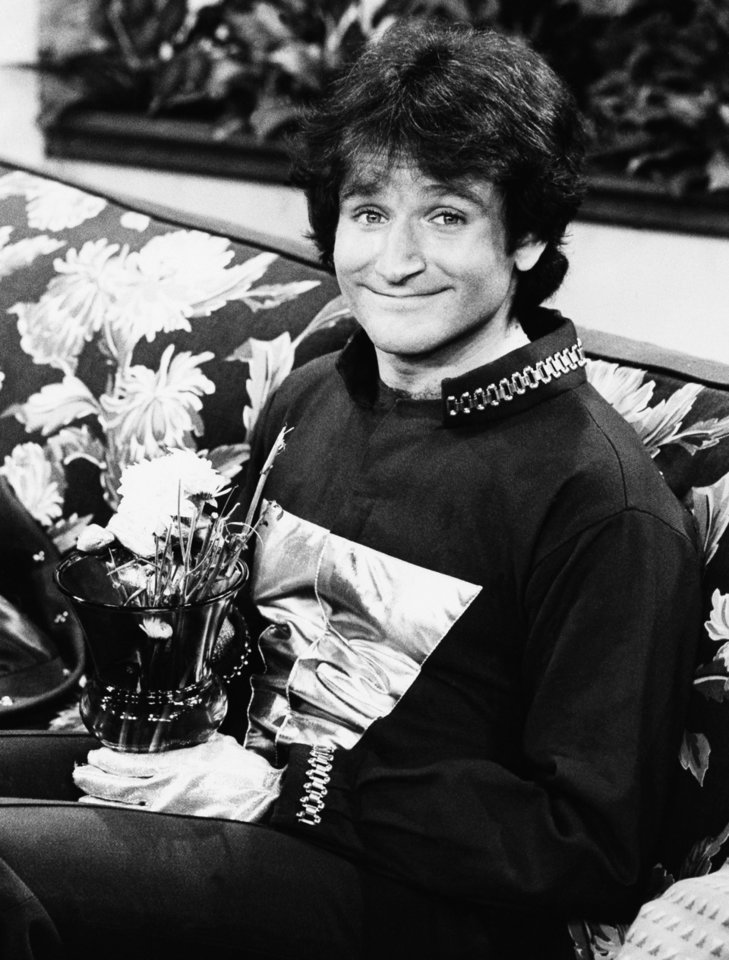 "Photo - FILE - This 1978 file photo originally released by ABC shows actor Robin Williams on the set of ABCs ""Mork and Mindy."" Williams, whose free-form comedy and adept impressions dazzled audiences for decades, has died in an apparent suicide. He was 63. The Marin County SheriffÂ's Office said Williams was pronounced dead at his home in California on Monday, Aug. 11, 2014. The sheriffÂ's office said a preliminary investigation showed the cause of death to be a suicide due to asphyxia. (AP Photo/ABC, File)"