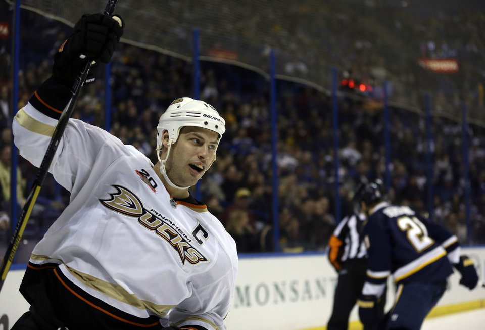 Photo - Anaheim Ducks' Ryan Getzlaf, left, celebrates after scoring as St. Louis Blues' Patrik Berglund, of Sweden, skates in the background during the first period of an NHL hockey game, Saturday, Jan. 18, 2014, in St. Louis. (AP Photo/Jeff Roberson)