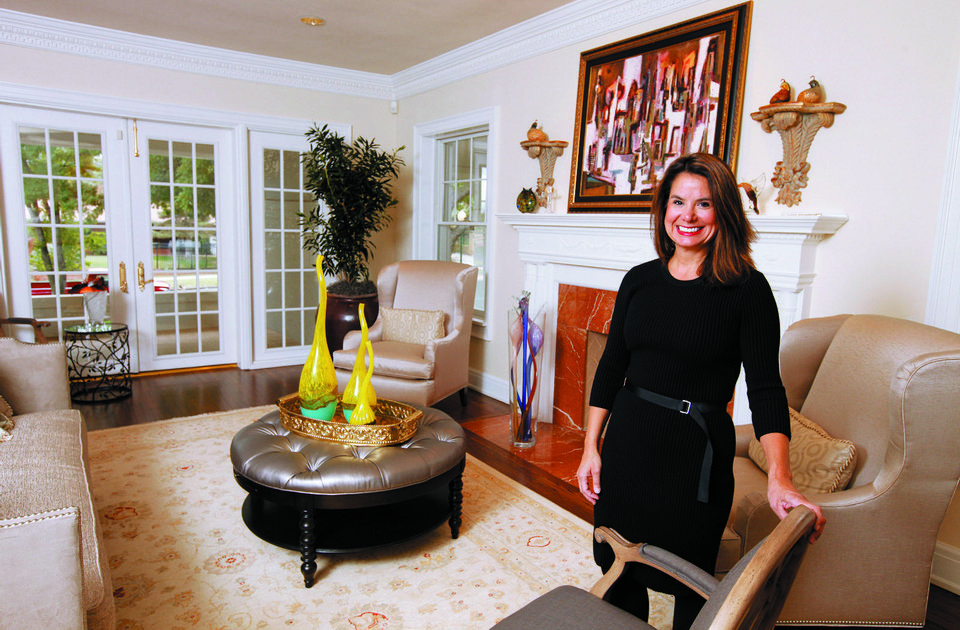 Photo - Dr. Diana Hampton shows the living room of her home at 1715 N Hudson in Heritage Hills, The 47th Historic Home Tour is this weekend.  PAUL B. SOUTHERLAND - The Oklahoman