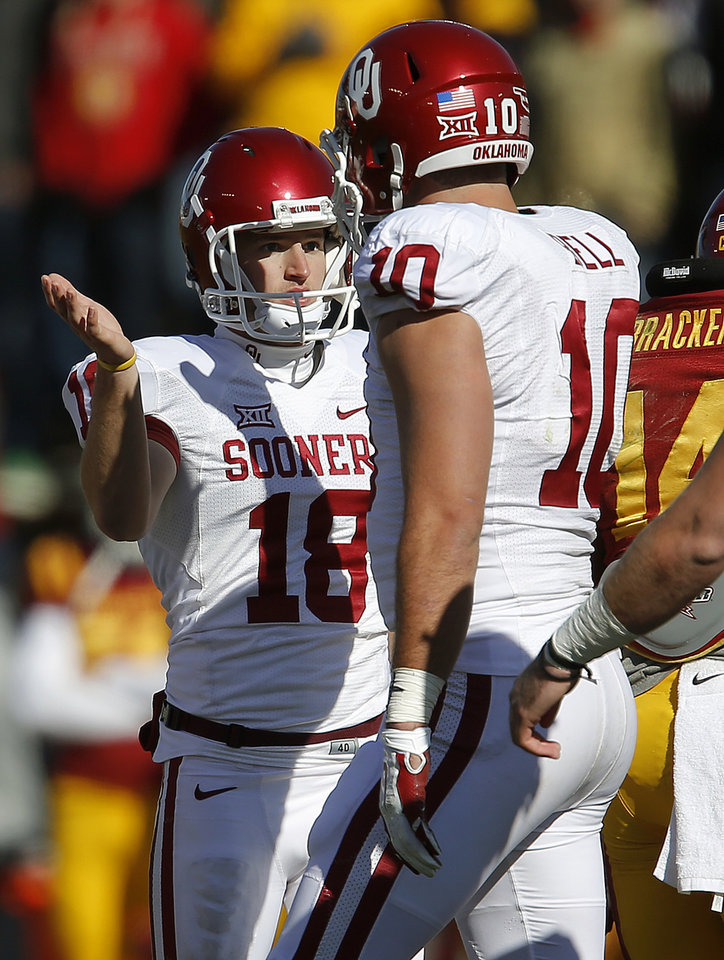 Photo - Oklahoma's Michael Hunnicutt (18) celebrates with Oklahoma's Blake Bell (10) after making a field goal during a college football game between the University of Oklahoma Sooners (OU) and the Iowa State Cyclones (ISU) at Jack Trice Stadium in Ames, Iowa, Saturday, Nov. 1, 2014. Photo by Bryan Terry, The Oklahoman