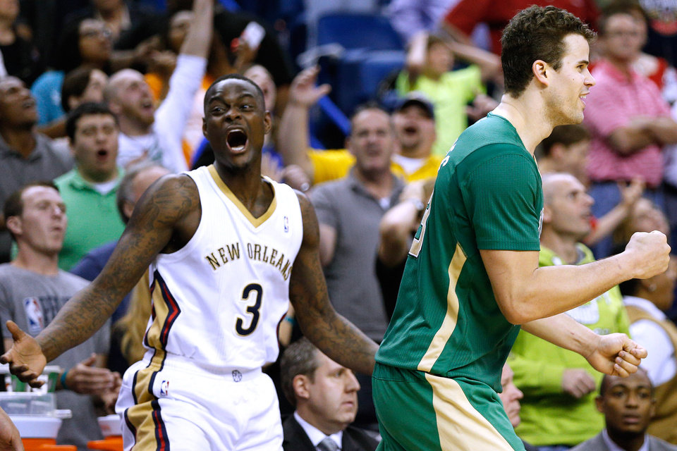 Photo - Boston Celtics center Kris Humphries (43) celebrates in front of New Orleans Pelicans guard Anthony Morrow (3) after scoring a last second basket to force the game into overtime during an NBA basketball game in New Orleans, Sunday, March 16, 2014. The Pelicans won 121-120. (AP Photo/Jonathan Bachman)
