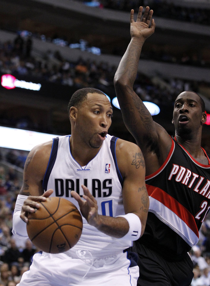 Dallas Mavericks\' Shawn Marion (0) comes down with a defensive rebound in front of Portland Trail Blazers center J.J. Hickson (21) during the first half of an NBA basketball game, Monday, Nov. 5, 2012, in Dallas. (AP Photo/Tony Gutierrez)