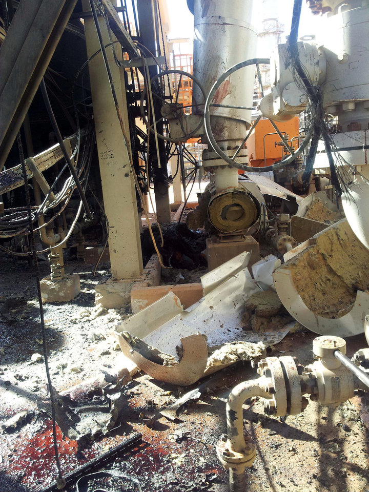Photo - This recent but undated view made available Monday Jan. 21, 2013, showing the damaged natural gas plant after Islamist militants attacked it and took hostages at Ain Amenas, Algeria.  The militants were wearing Algerian army uniforms and were equipped with explosives to blow up the plant, according to Algeria's Prime Minister Abdelmalek Sellal, who said Monday that at least 81 people died in the four-day operation by government forces to liberate the hostages, including 32 Islamist militants. Five foreigners are still reported as missing. (AP Photo)