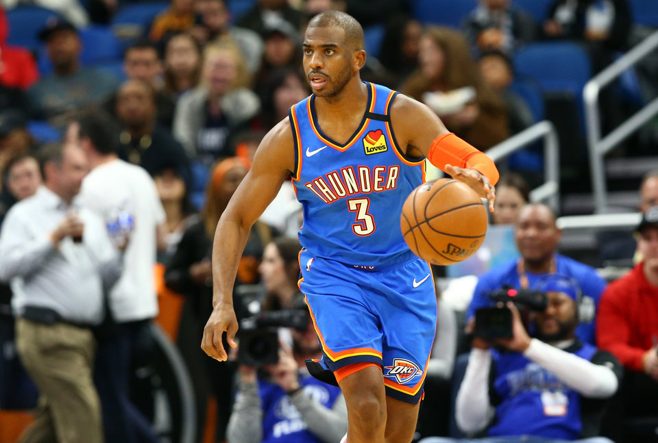 Photo - Jan 22, 2020; Orlando, Florida, USA; Oklahoma City Thunder guard Chris Paul (3) drives to the basket against the Orlando Magic during the first half at Amway Center.  [Kim Klement/USA TODAY Sports]