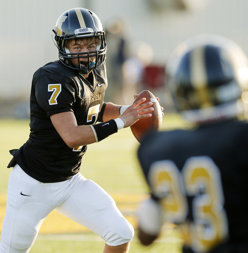 Photo - Midwest City quarterback Kilby McGuire (7) looks to pass during the high school football game between Midwest City and Edmond Santa Fe at Rose Field in Midwest City, Okla., Thursday, Aug. 30, 2012. Photo by Nate Billings, The Oklahoman