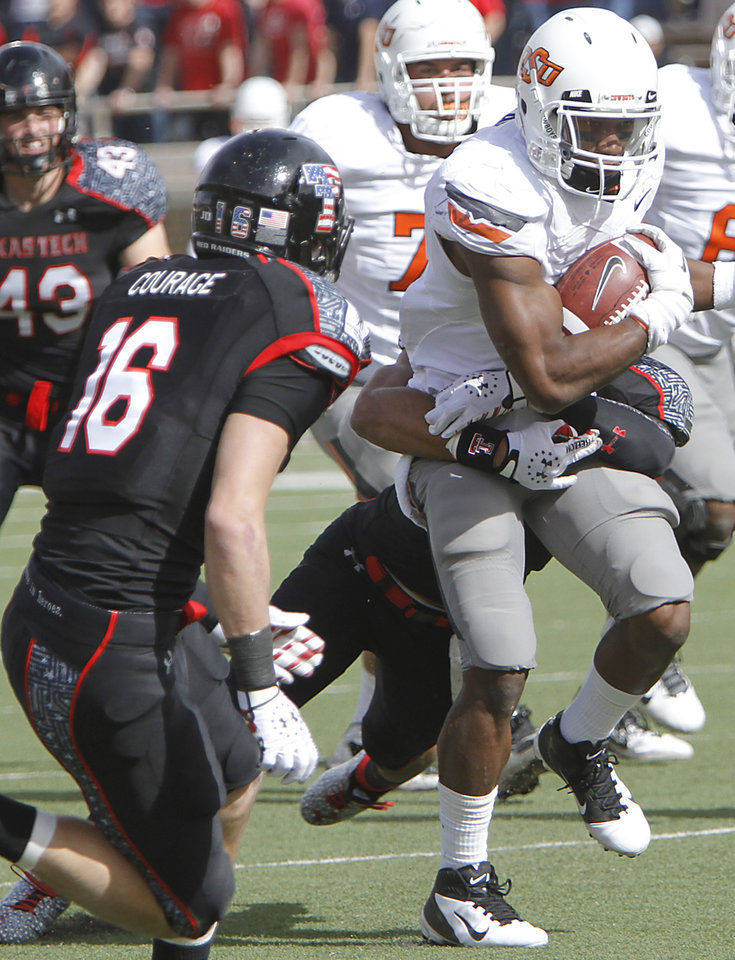 Photo - Oklahoma State Cowboys running back Joseph Randle (1) runs with the ball through the Texas Tech defense during the college football game between the Oklahoma State University Cowboys (OSU) and Texas Tech University Red Raiders (TTU) at Jones AT&T Stadium on Saturday, Nov. 12, 2011. in Lubbock, Texas.  Photo by Chris Landsberger, The Oklahoman  ORG XMIT: KOD